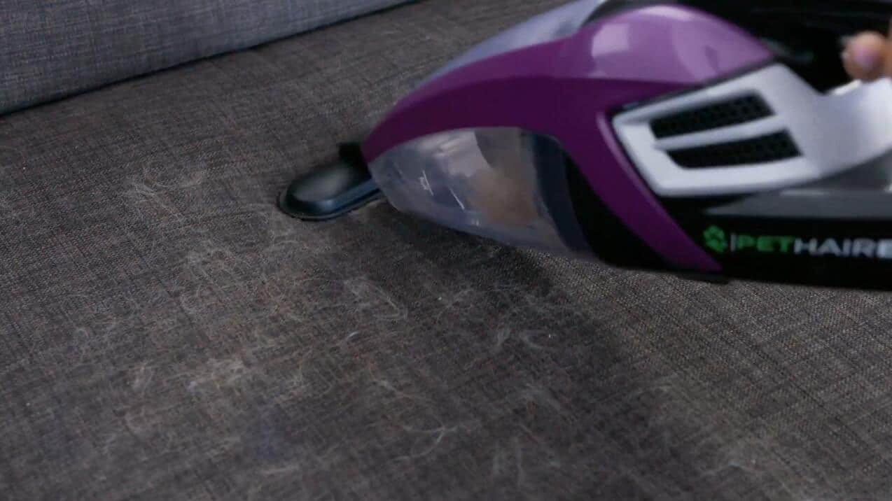 Get Hair off Clothes with handheld vacuum